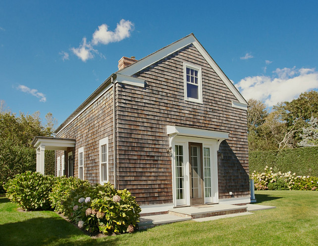 Aged cedar shake siding. Cottage with aged cedar shake siding. #cedarshakesiding #AgedCedarShakes Via Sotheby's Homes.