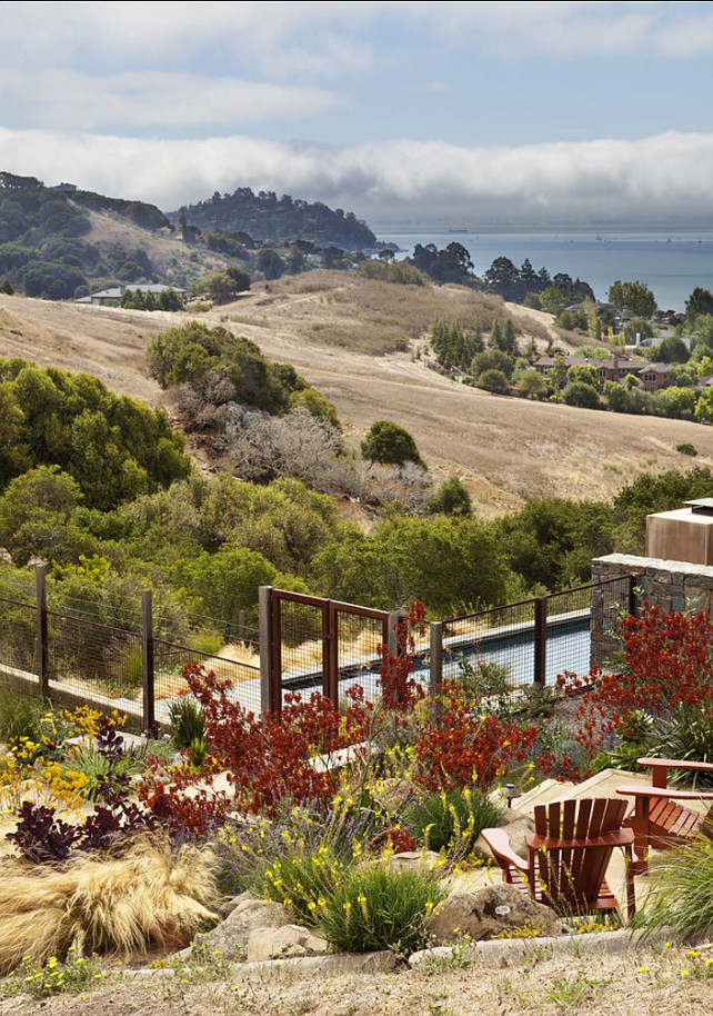 The meandering path and sitting area nestle in a warm pallet of colors maximizing the use of the side property and views of the San Francisco Bay.  #Gardening #Landscpaing