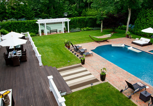 Backyard Plan Ideas. Beautiful backyard plans for the whole family. The backyard view from the upper deck shows off the pool and tennis courts.#BackyardPlanIdeas #Backyard #BackyardDesign