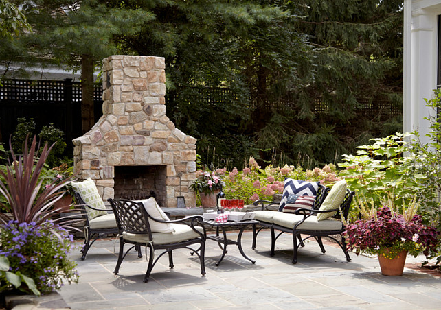 Backyard with natural stone - Bluestone Patio and Outdoor Fireplace. Jules Duffy Designs.