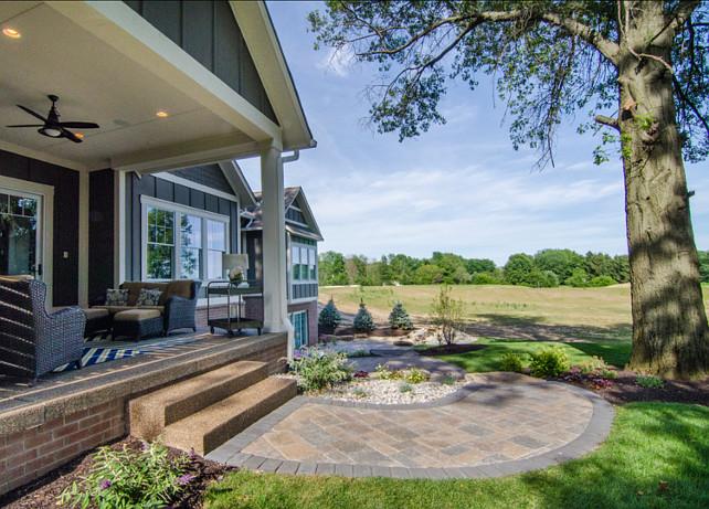 Backyard. Backyard with beautiful landscaping and porch. #Backyard #BackyardIdeas #BackyardDesign #Landscaping #Porch #PatioFurniture
