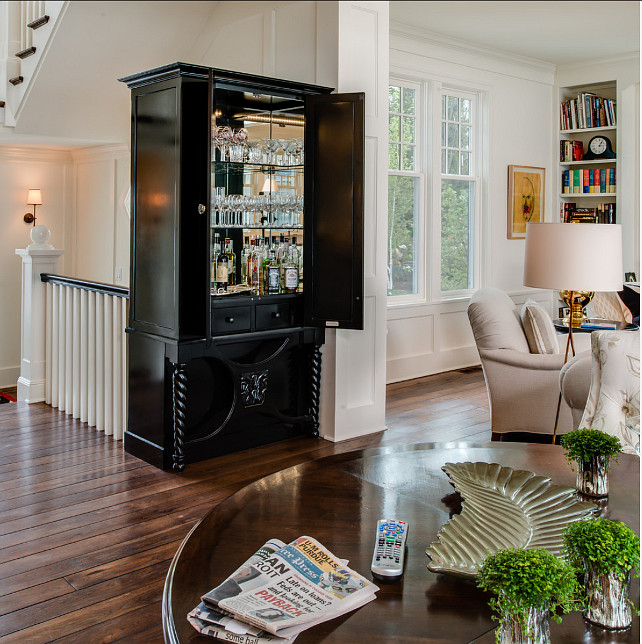 Bar Ideas. Custom cabinet hides a convinient and elegant bar. #Bar #Cabinet #BarIdeas #HiddenBar