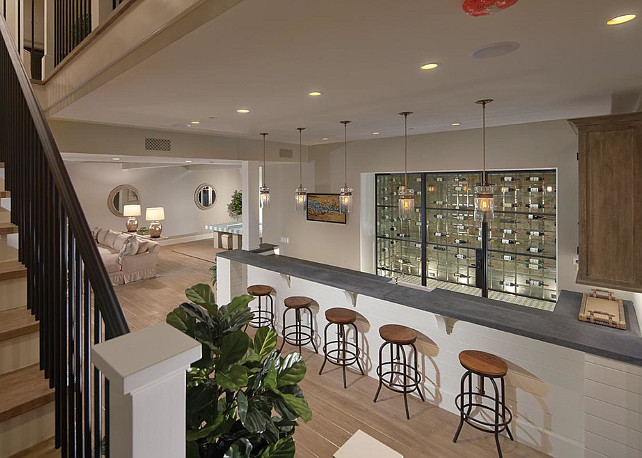 Basement. Basement Ideas Basement Design. This basement has a bar with built-in wine room. #Basement #BasementIdeas #BasementDesign #Wineroom