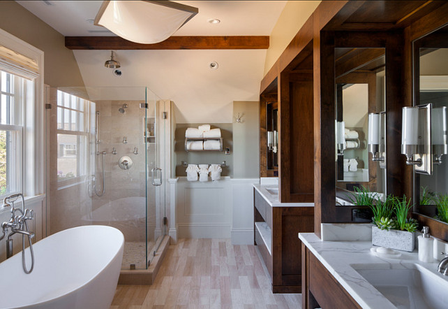 Transitional Bathroom Design. This transitional bathroom is full of inspirational ideas, including the large double vanities with dark stained wood and white marble. #BathroomDesign #BathroomIdeas #BathroomVanity