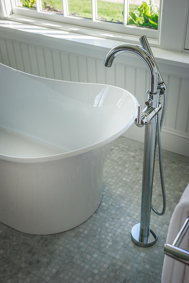 Bathroom Ideas. A free-standing tub sits on eye-catching mosaic Carrera marble flooring. #Bathroom