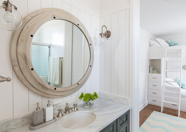 Bathroom Mirror and Sconces. The bathroom sconces are the Hinkley Lighting Congress 1 Light Sconce. Mirror is the Noir Porthole Mirror from Candelabra. #Bathroom #Mirror #Sconces Laura U, Inc.