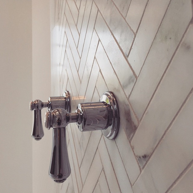 Bathroom Shower Faucet by Perrin and Rowe. This is the perfect match with the white calacata herringbone wall. Graystone Custom Builders