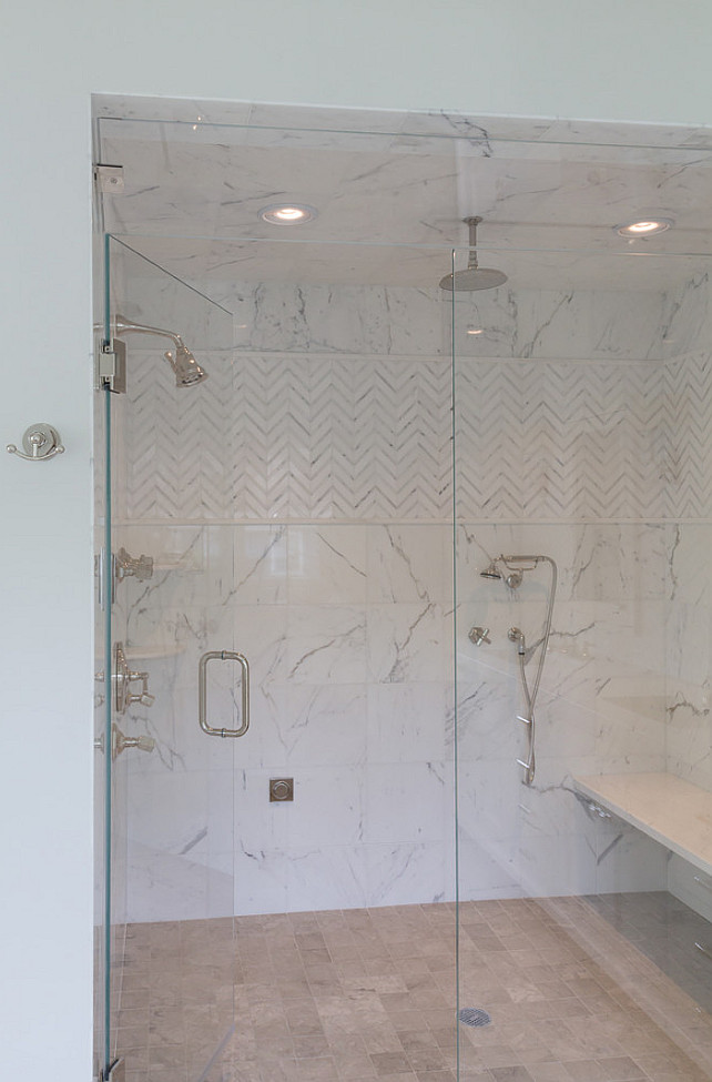 Bathroom Shower. Bathroom with steam shower. Shower tiling. Shower with glass door and marble bench. #Bathroom #Shower Blue Water Home Builders.