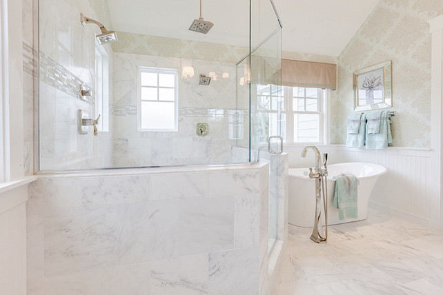 Bathroom Tiling. Bathroom Tiling Ideas. This traditional bathroom features carrara marble tiles for a seamless look. #BathroomTiling #Bathroom #Tiles #CarraraMarbleTiles