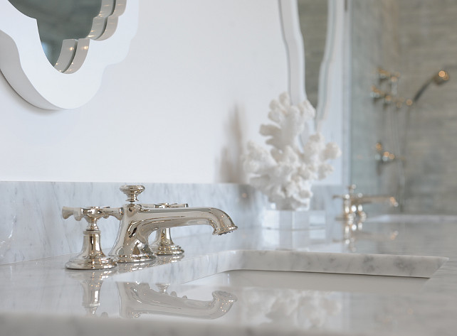 Bathroom countertop. Bathroom countertop ideas. Bathroom features polished white marble countertop with polished nickel bathroom faucet. #Bathroom