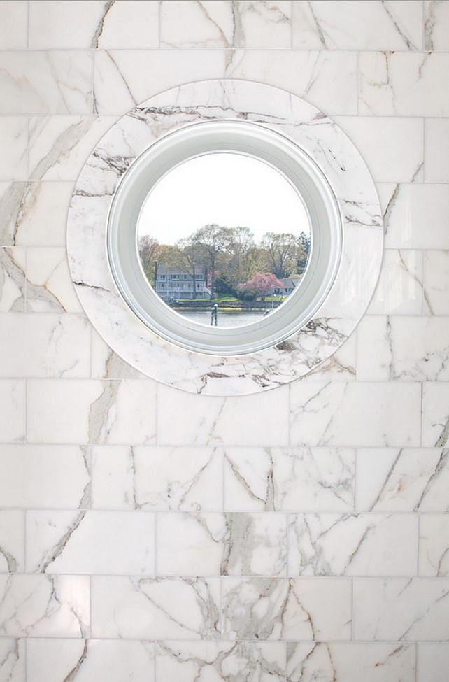 Bathroom window. Round bathroom window. Bathroom window with marble tile wall. #Bathroom #window