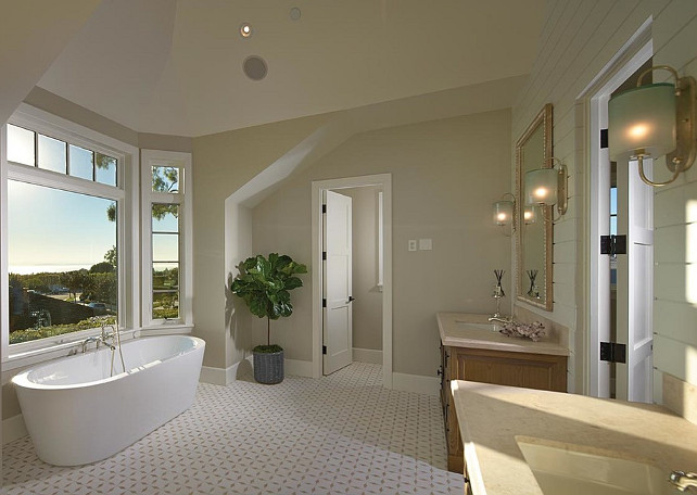 Bathroom. A contemporary freestanding tub stands in the foreground paired with a mounted tub filler