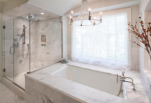 Bathroom. Bathroom Design. The master bathroom features frameless glass shower panels, Calacatta marble, and quality fixtures. #Bathroom