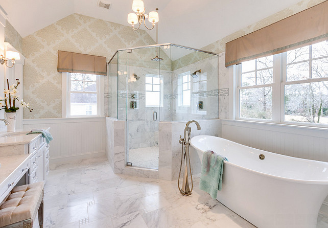 Bathroom. Bathroom with Soaking tub, glass shower, mini-chandelier from the Progress Lighting Fortune collection, marble floors - this master bath embodies spa-like luxury! The freestanding tub filler is the Brizo Virage: Single-Handle Freestanding Tub Filler. #Bathroom