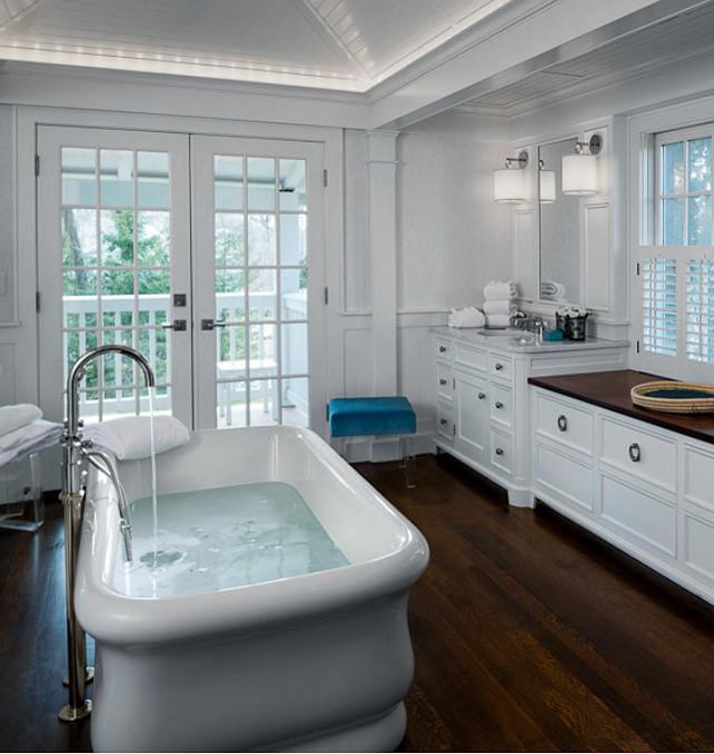 Bathroom. Bathroom with freestading bath, marble countertop and hardwood floors. #Bathroom #BathroomDesign #BathroomIdeas Designed by Sean O'Kane AIA Architect P.C. - Photo by Barry A. Hyman