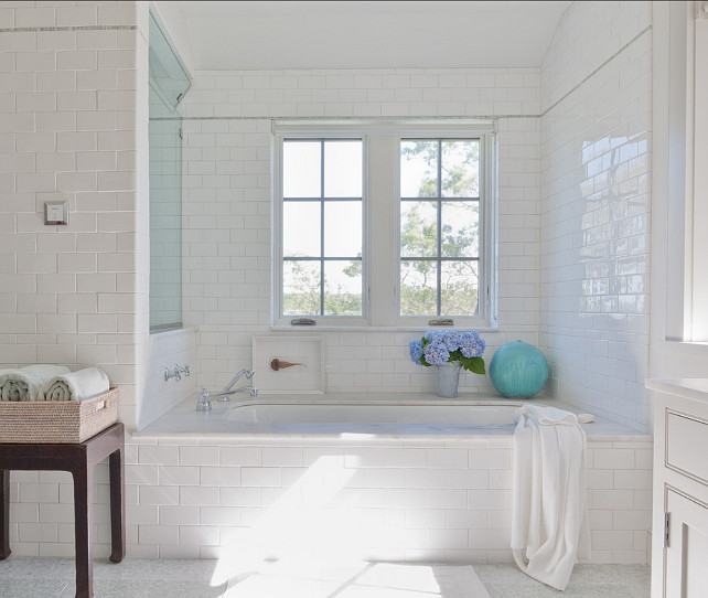 Bathroom. Bathroom with white subway tiles, bathtub with marble slab and Calacatta marble flooring. #Bathroom #BathroomIdeas   Wettling Architects.