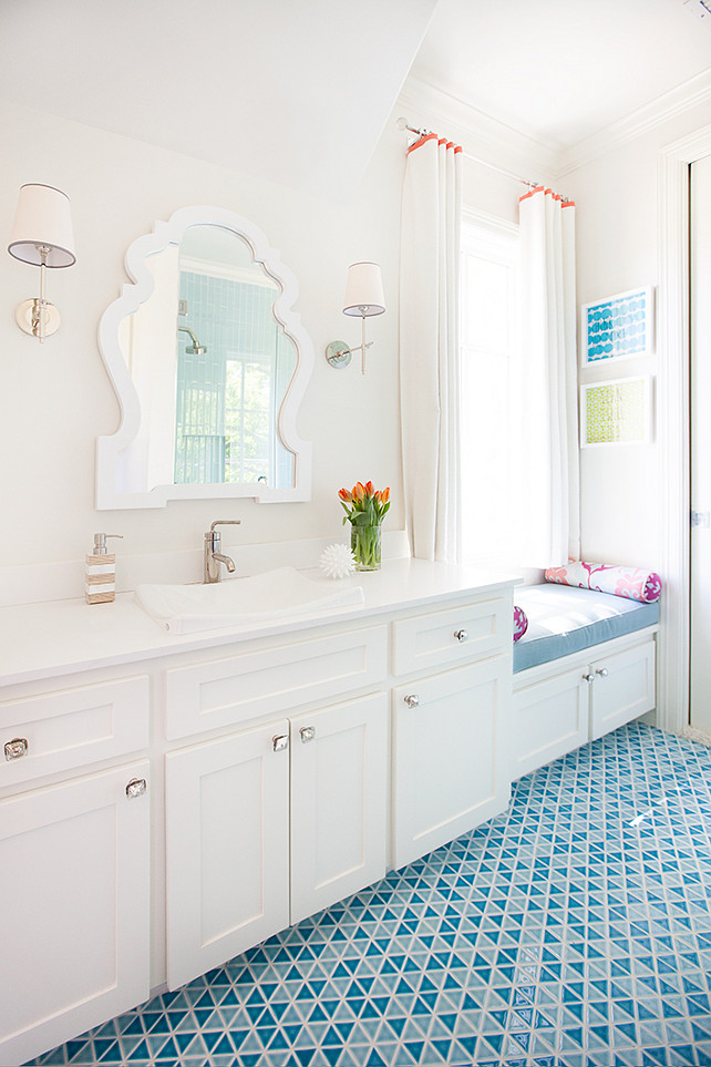 Bathroom. Kids Bathroom Ideas. Kids Bathroom with playful design. The mirror is from Jonathan Adler. #Bathroom #KidsBathroomDesign #BathroomDecor Tracy Hardenburg Designs.