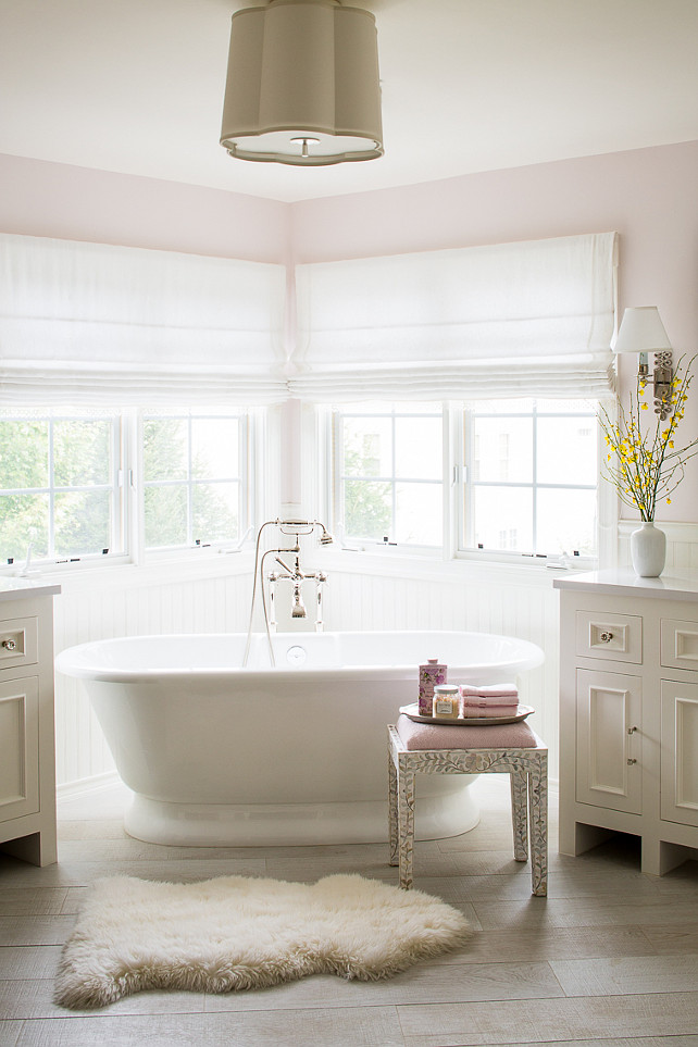 Bathroom. Pale Pink Bathroom. Pale Pink Paint Bathroom. Ivory and Pink Bathroom. Bathroom lighting is Barbara Barry Simple Scallop Pendant. #Bathroom #IvoryBathroom #PalePink #PinkBathroom