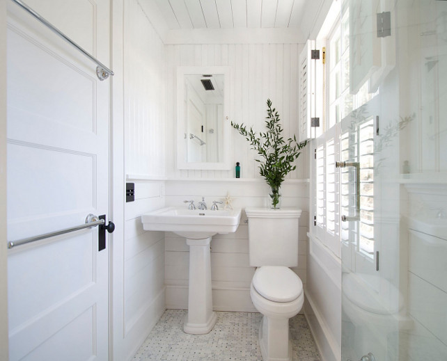 Bathroom. Small Bathroom Small white bathroom with plank boards and beadboard walls. #Bathroom #SmallBathroom #PlankBathroom #PlankBoards #BeadboardBathroom #Beadboard