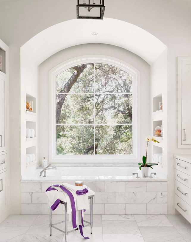 Bathroom. White Bathroom with big window above bathtub. #Bathroom #WhiteBathroom #BathroomWindow Ryan Street and Associates
