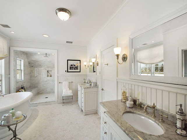 Bathroom. White Bathroom with marble flooring, separate shower and freestanding bathtub. #Bathroom Sotheby's Homes.