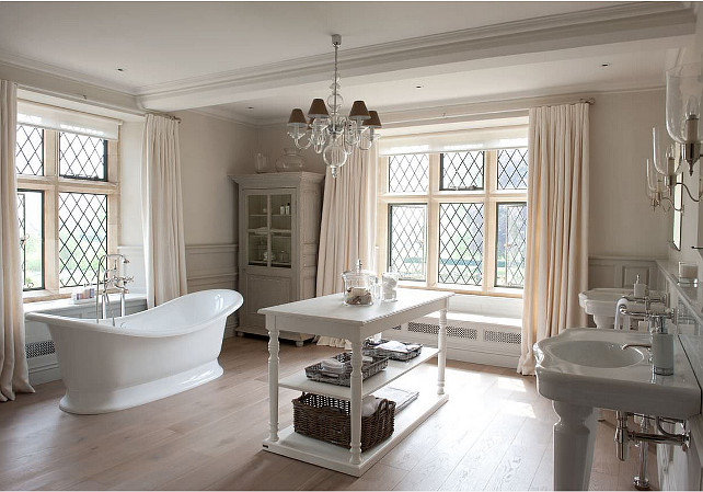 Bathroom. Bath  bathroom  bathroom curtains  bathroom table  chandelier  chandeliers  console tables  curtains  freestanding bath  his and her  Lead lined windows  leaded glass windows  roll top bath  wall lights  white bathroom  wide oak floorboards  wood panelling #Bathroom