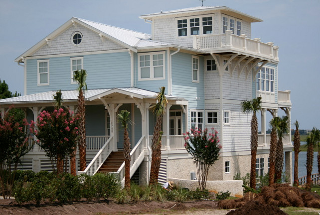 Turquoise Beach House. Beach House Exterior. Beach House Exterior Paint Color. Beach House Exterior Paint Color Ideas. Beach House Exterior Ideas. Beach House with key west, tongue & groove, brackets, oyster tabby, cool, widow's watch, palm tree, blue, cedar shingle, shake, metal roof. #BeachHouse #PaintColor Tongue & Groove Custom Builder.