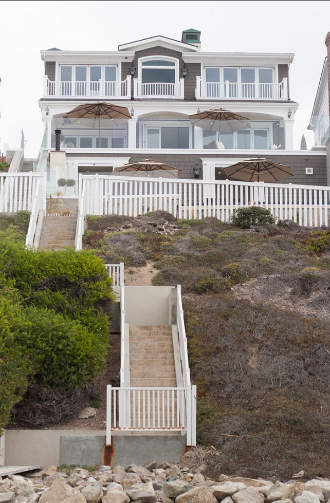 Classic beach house with coastal interiors home bunch for Beach design homes