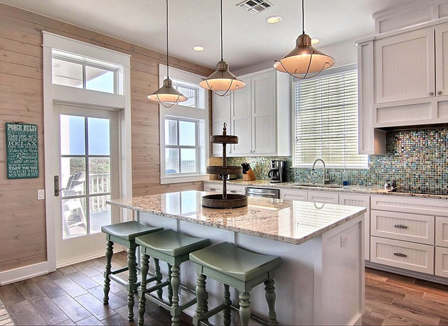Beach house kitchen with coastal design. Cinnamon Shore via House of Turquoise.