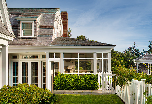 Beach house. Beach Cottage. Cape cod. Cedar shake. Collumns Double gambrel. Gambrel roof. Martha's Vineyard. Massachusettes. New England. Screened porch. Garden. Picket Fence. White Picket Fence. Shake roof. Shakes. Single exterior. Summer house