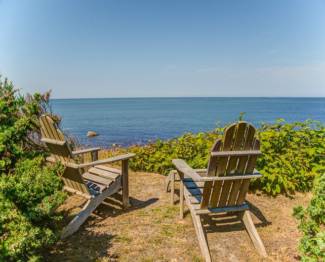 Beach with Adirondack chairs. #Adirondackchair #beach Via Sotheby's Homes.