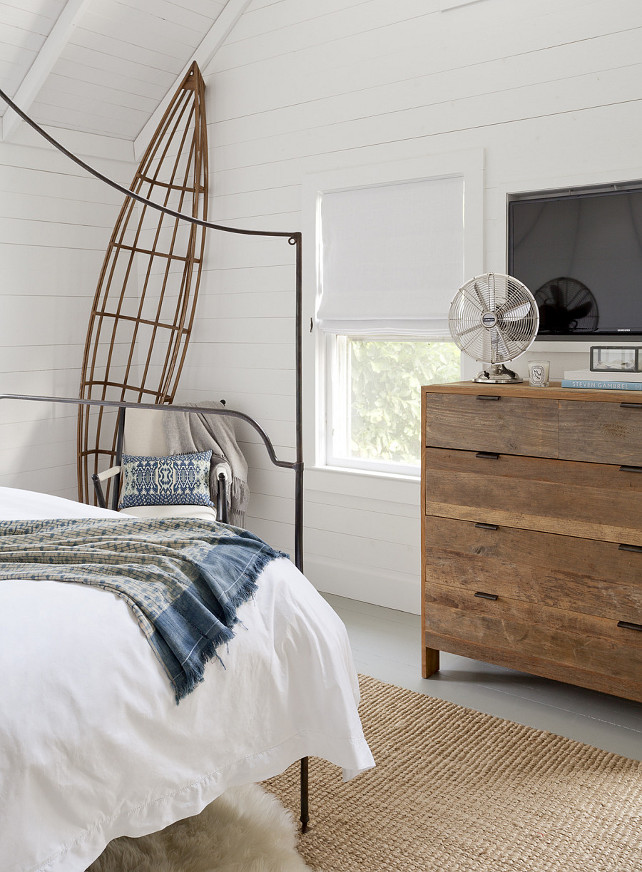 Beachy Bedroom. Beach House Bedroom. Beach house bedroom with beachy decor. Bed is the Anthropologie Italian Campaign Canopy Bed. Reclaimed wood dresser is by Restoration Hardware. Rug is jute. #bedroom