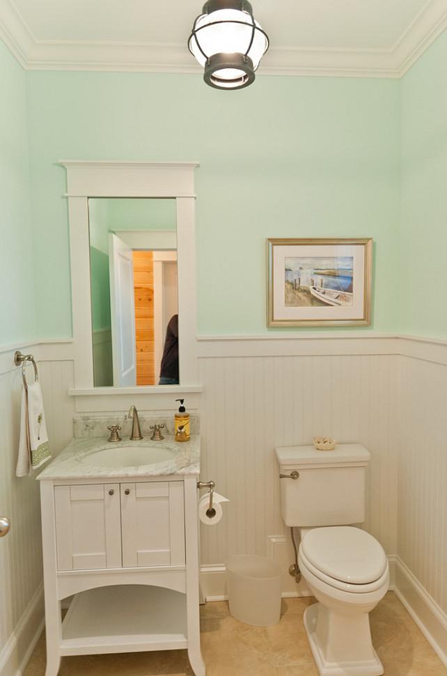 Beach house with casual coastal interiors home bunch for Sky blue bathroom designs