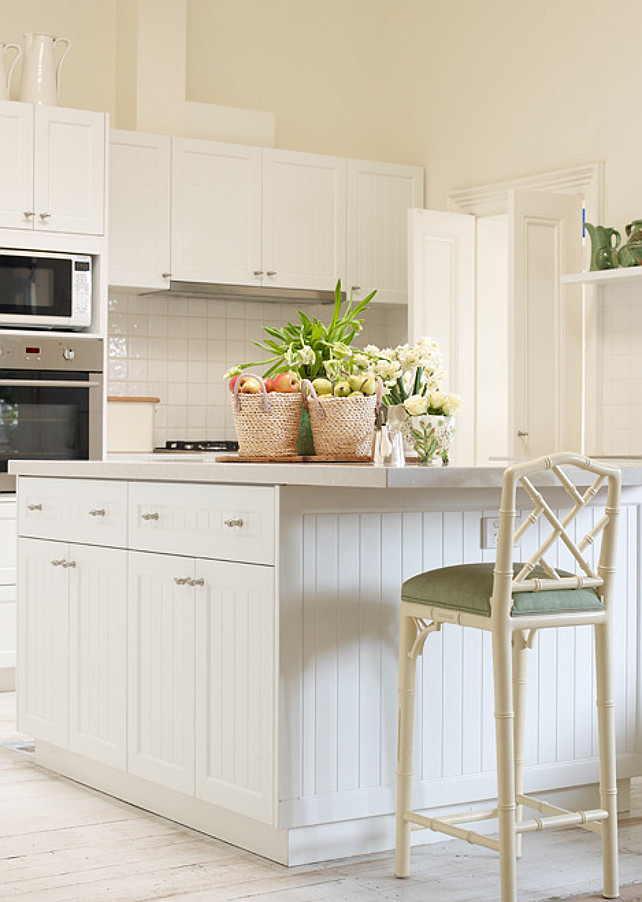 Beadboard Kitchen Island. White Beadboard Kitchen Island Ideas. Beadboard Kitchen Island Design. Beadboard Kitchen Island White beadboard kitchen island with gray top lined with ivory faux bamboo bar stool. Adelaide Bragg.