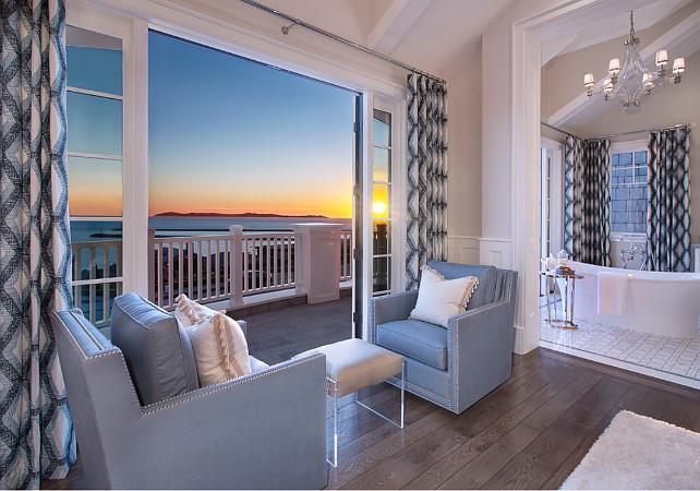 Bedroom Sitting Area. Bedroom Sitting Area with blue chairs, hardwood floors, ocean view, blue draperies. Bedroom sitting area opens to the master bathroom. #Bedroom #SittingArea Spinnaker Development.