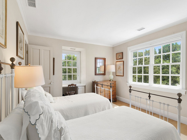 Bedroom. Cottage Bedroom with antique iron beds painted in white with crisp white bedspread. #Bedroom #GuestBedroom #CottageBedroom #WhiteBedspread