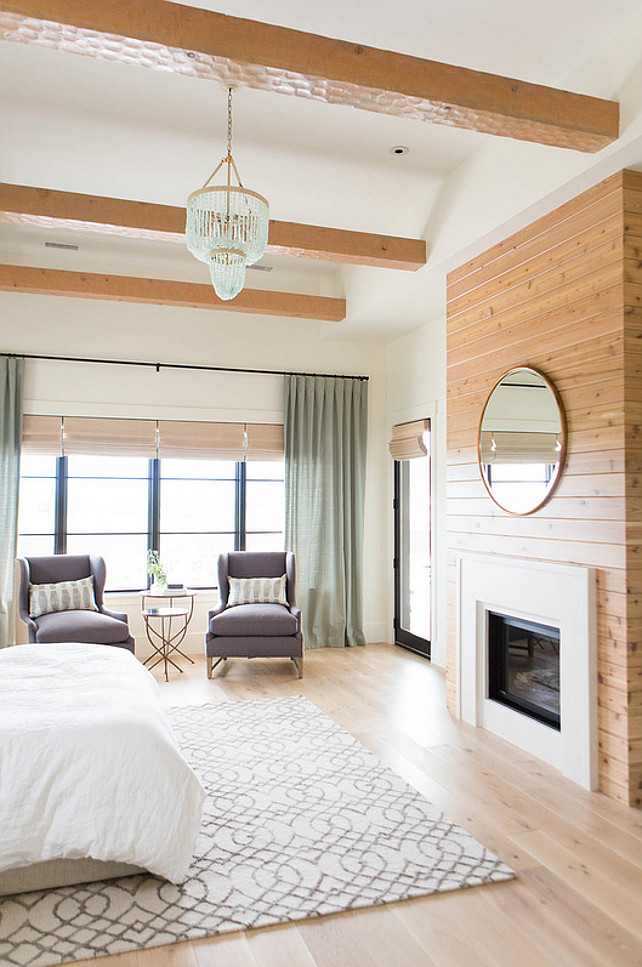 Bedroom. Master Bedroom Fireplace. Master bedroom with fireplace, seating area, ceiling beams and seafoam coastals chandelier. #Bedroom #MasterBedroom #FireplaceAshley Winn Design.