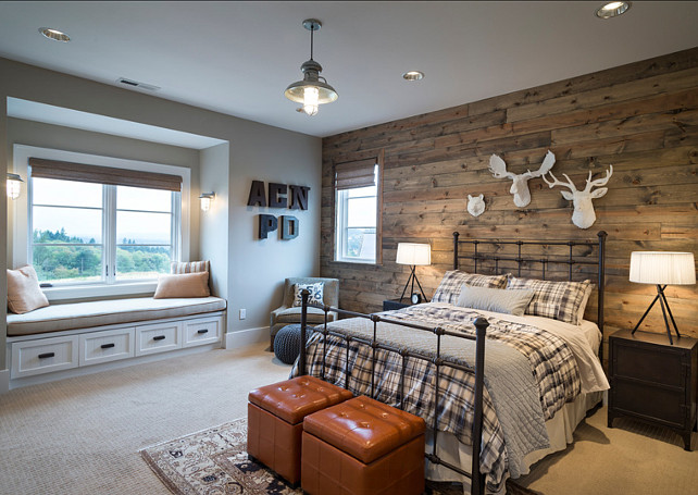 Bedroom. Rustic Bedroom Design. Bedroom with reclaimed barnwood. The boys bedroom features white animal heads, barn wood paneling, hanging light, metal side tables, tripod lamps, storage cubes, metal letters, built in window seat and plaid bedding. #Barnwood #ReclaimedBarnwood