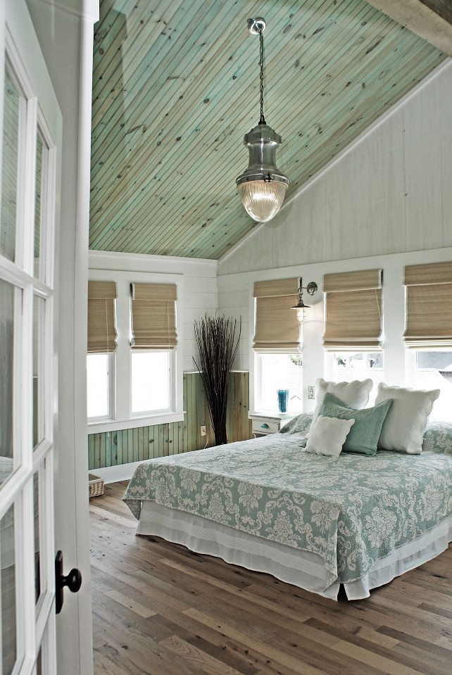 Bedroom.  Coastal Bedroom. Aqua Bedroom. Coastal aqua bedroom. The ceiling wood is finished with highly diluted aqua tint to give it just a hint of color and left without varnish to assure the wood looks natural and that there is no reflection. The light fixture is the Vintage Streetlight Prism Pendant from Restoration Hardware. The bed linens are from Manuel Canovas. The window shades are Extreme Woven Lorena Natural 27 w/ White Edge Binding & White BO Liner. #Bedroom #Aqua #PaintColor #Coastal