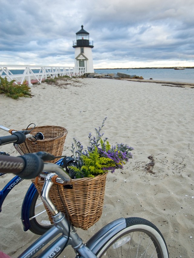 Bike on the beach. Vintage bike on the beach with flower basket. Lighthouse.