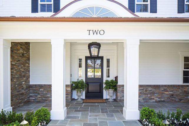 Black Door Front Entry. Black Door Front Entry Ideas. Black Door Front Entry Decor. Front entry with stone flooring porch and black door. #BlackDoor #FrontEntry Kelly Nutt Design.