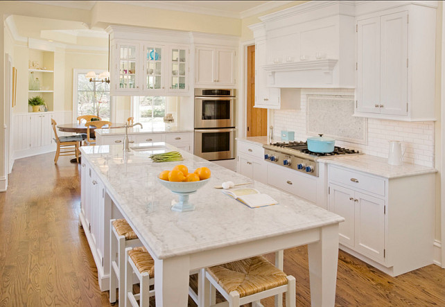 Crisp White Kitchen Design. I am loving the paint color of this Crisp White Kitchen. #CrispWhiteKitchen #KitchenDesign