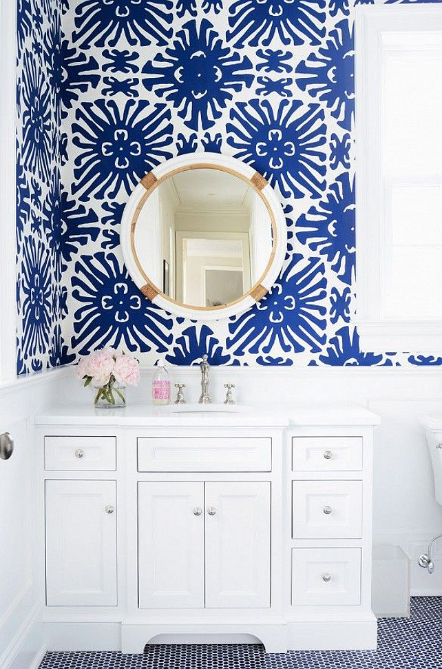 Blue and white Wallpaper. Blue and white wallpaper with round mirror from Serena and Lily in bright white bathroom #BlueanWhite #Wallpaper #Bathroom Via Domaine Home.
