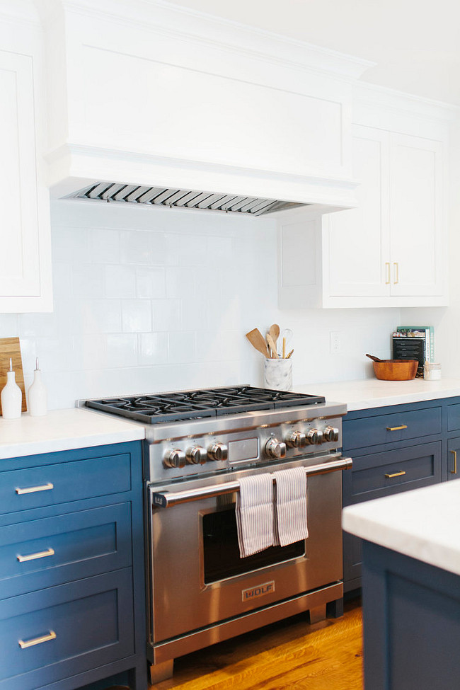 This navy blue and white kitchen features white 6x6 tile backsplash. #glossywhite #6x6Tiles #Backsplash Shea McGee Design.