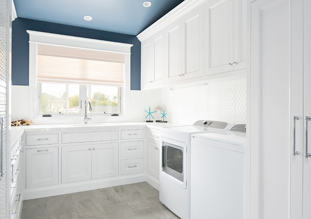 Blue and white laundry room. Laundry room with white cabinets and blue paint on walls and ceiling. #BlueandWhite #LaundryRoom Brandon Architects, Inc.