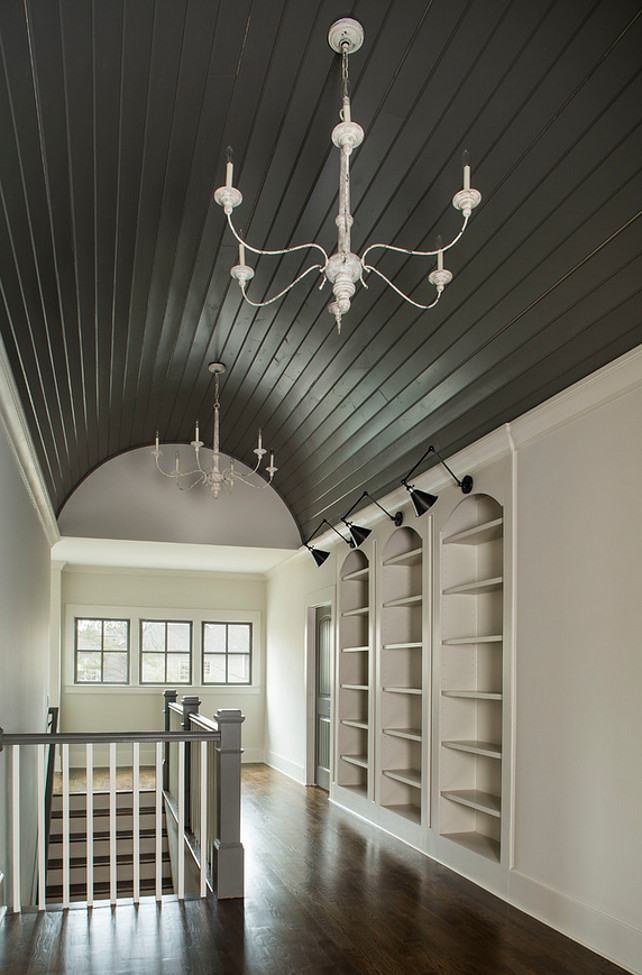 Bookcase hallway ideas. Landing area with built-in bookcase and vaulted barrel ceiling. Vikki Werbalowsky from La Bella Vie.