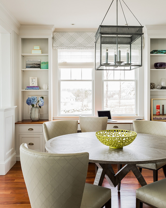 Breakfast Nook. Kitchen Breakfast Nook Ideas. Transitional breakfast nook with square gray lantern pendant and cabinets framing window. #BreakfastNook #Kitchen   Jennifer Palumbo.
