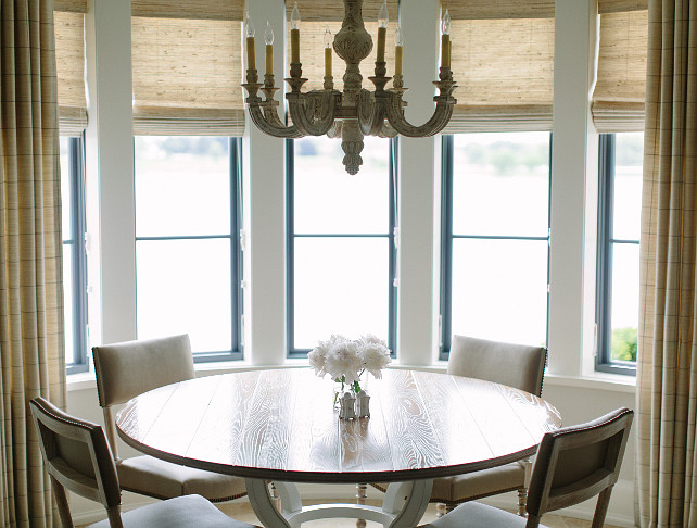 Breakfast Room with shades and curtains. Breakfast Room with bay windows covered with shades and curtains. Kate Marker Interiors.