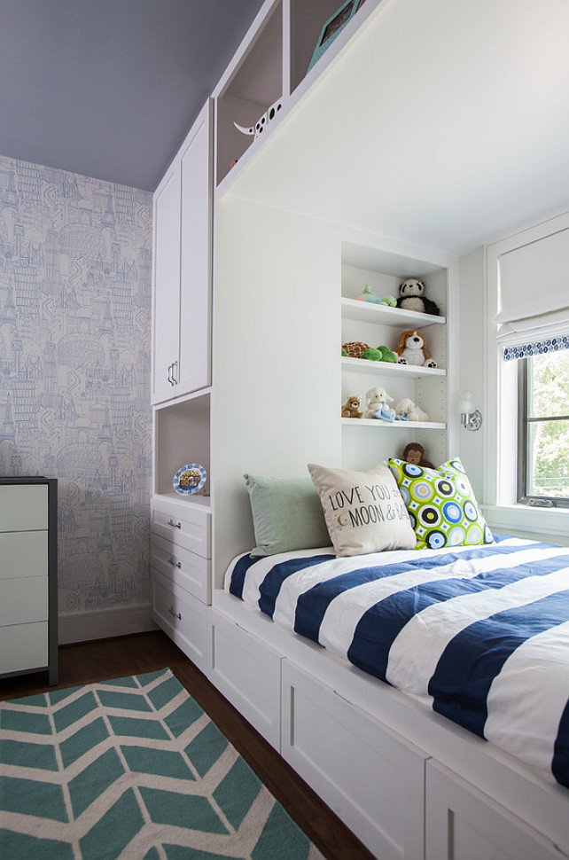 Built-in Bed with wardrobe. Kids bedroom with custom built-in bed and wardrobe. The wallpaper is Globetrotter Blue. #KidsBedroom #BoysBedroom #BuiltinBed #BuiltinWardrobe Laura U, Inc.