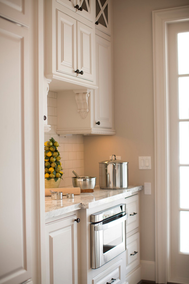 Butlers Pantry with built-in microwave oven. #ButlerPantry Whitestone Builders.